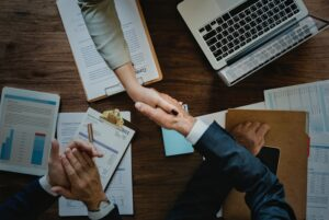 a business agreement with two people shaking hands