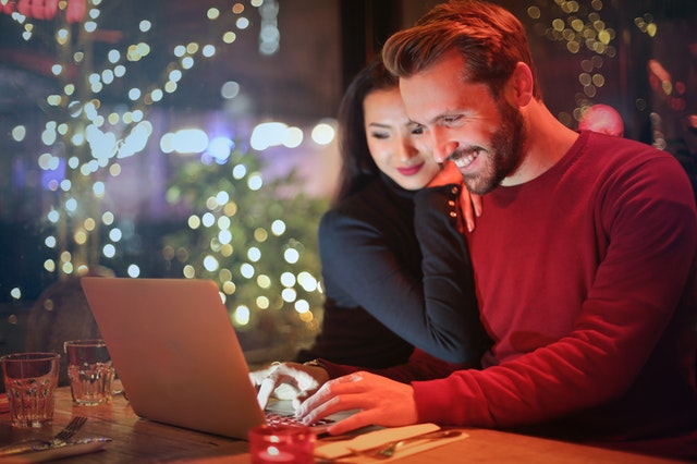 A happy couple shopping online