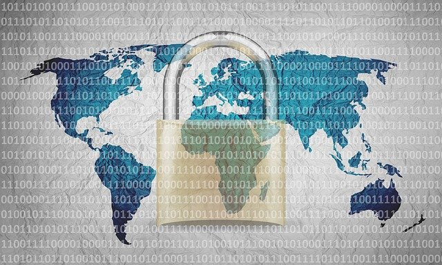 binary code over a map of the world and a padlock