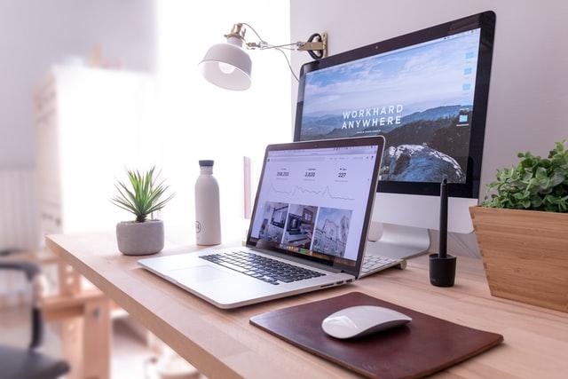 dual screen mac setup showing website and site traffic