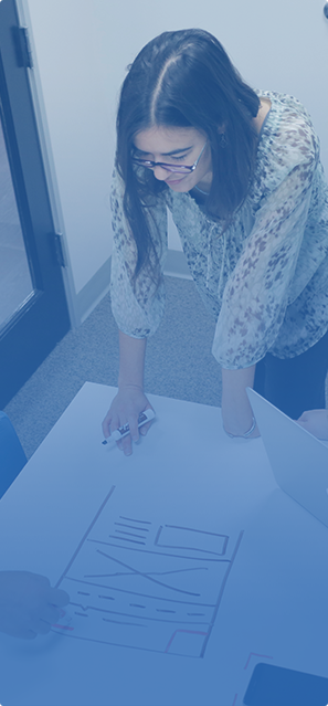 a young woman working on a chart on a white table