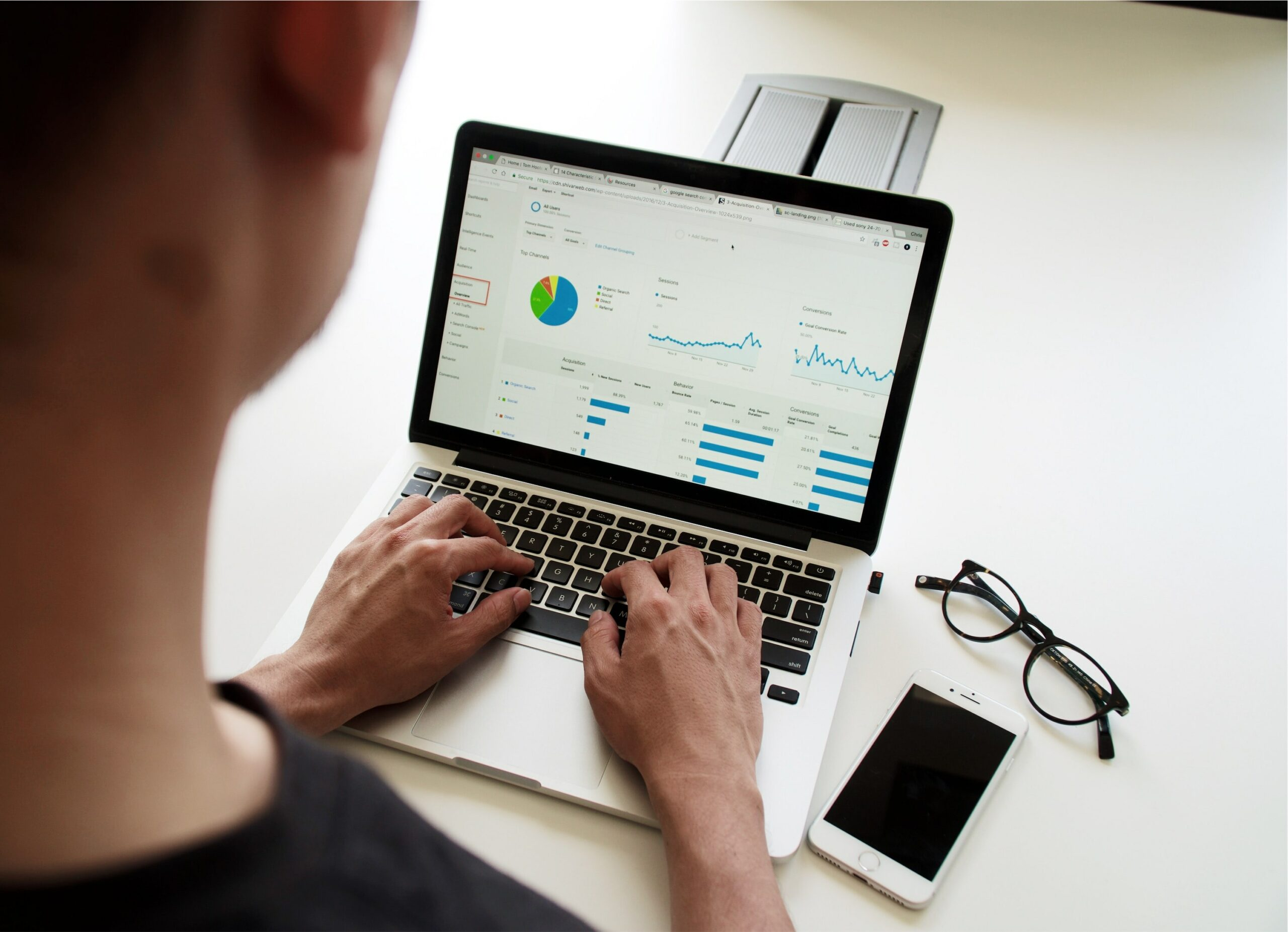 person viewing analytics on laptop