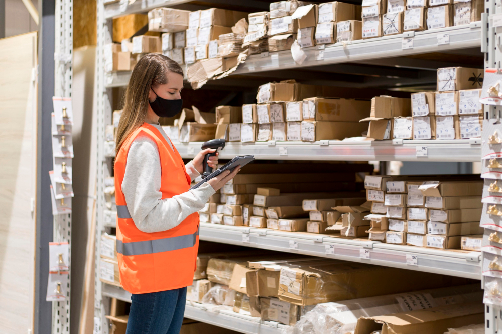 woman doing inventory in a warehouse